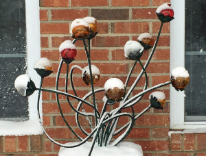 "Welded steel formed rods with forged steel simi-spheres and colored glass balls. To be installed in a garden amongst hosta and such. 24"" high."